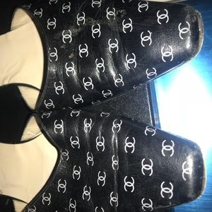 Chanel Vintage Slip Ons with Chanel logo.